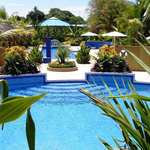 Alma's pool, perfectly situated within a tropical garden setting.
