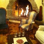 A welcome drink by the fire on arrival