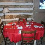 Private dining for 2 or for 8 in the log cabin.
