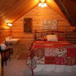 The Old Mill Log Cabins Foto