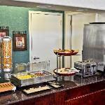 A Free Full Hot Breakfast, w/Eggs, Omelets, Bacon, Sausage, Fresh Waffles and more...