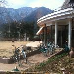 free bicycles and exterior of breakfast room. Mt Fuji on other side of that mountain in the back