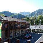 View of mountains from top rooms across parking lot, jacuzzi rooms, and heated pool.