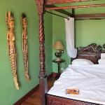 This is room # 11.  Second floor balcony. Note the charming Thai wood carvings on the wall and t
