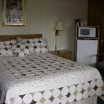  Charming quilt on a comfortable bed!