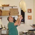 Owner tossing pizza