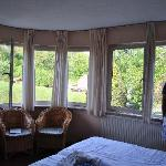 Large room (14) with a view over the fields