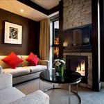 Schist fireplaces feature in all rooms, along with floor-to-ceiling windows.