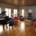 The grand piano and the fireplace in the living room