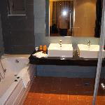 nice clean bathroom with jet bath and shower