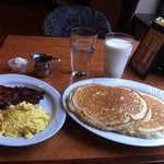 the fluffiest giant pancakes with eggs and bacon...$9 with a glass of milk!