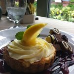 Lemon mousse custard at Roycroft Inn table looking out over the courtyard. homemade desserts, so