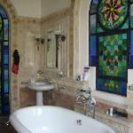  gorgeous bathroom with stained glass