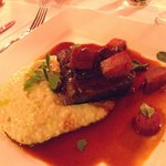 Braised Angus beef short rib in ancho Malbec jus with jalapeño, Tillamook sharp cheddar grits. P