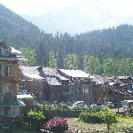 VIEW OF THE MOUNTAINS WITH A PART OF HOTEL MOUNTVIEW PAHALGAM