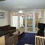 Cottage : Loverly spacious lounge leading to private decked patio.