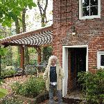  My sister outside the brick cottage