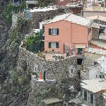 Our apartment is built in the rocks with the orange umbrella on the terrace