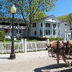 During the day, the horse drawn carriages clop by the front of the inn