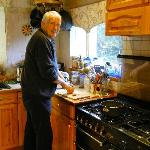 John Clifford helping to prepare breakfast.