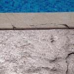 broken floor around pool