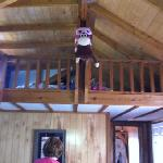 my kids back packs in loft of cabin 10