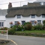 one of many thatched cottages