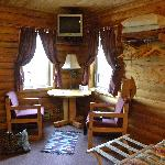 Our log cabin with table, chairs and TV