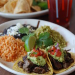 Try a variety of tacos on handmade corn tortillas hot off the griddle - carne asada (pictured ab