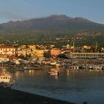 View of Etna at sunrise from the port of Riposto