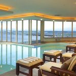 Swim in our heated pool or enjoy a treatment at Camelot Spa overlooking the airport and city sky