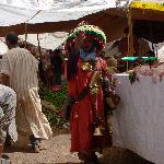  A water seller at the Monday Market, although take the bottled water the farm provides.