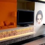 Whimsy Entertainment wall with extra large flat screen TV