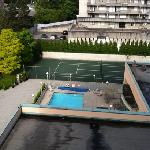 view of pool from balcony in room