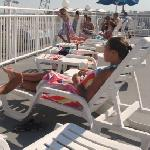 rooftop sun deck next to pool overlooking boardwalk