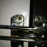 Safety lock on door missing screw, others stripped.