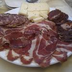 Big plate of Pata Negra, cured sausages and goat cheese