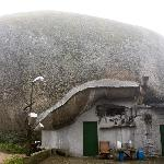 Home under a giant boulder near Casa Solotti