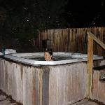The private hot tubs are surrounded by trees with white Christmas lights!
