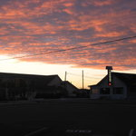  sunset over motel building