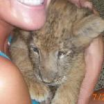 Cuddling the baby lion!