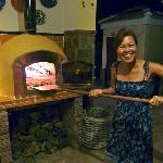Joan baking pizza's in the wood oven