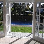 View from West Wing bedroom to pool and garden area