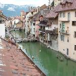 View from the room's balcony looking up the canal toward Lake Annecy