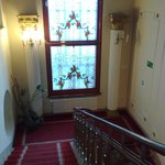 the red carpet on the stairway and the glass window