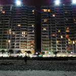 View of Bay Watch Resort from the beach at night