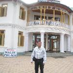  me standing Entrance gate of hotel