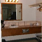 sink area with coffee pot