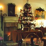 Traditional Christmas tree set on the parlor table in the Shrivers' home.
