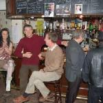 "Typical evening at ""The Moth"". Guests and locals enjoy a drink or two together"